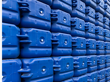Many blue plastic floating dock cubes