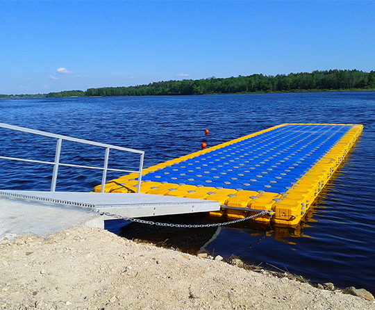 Floating dock for sale in blue and yellow on the sea