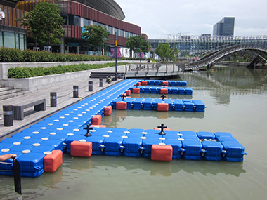 Round Times Square in Suzhou with floating dock on the lake