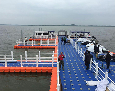Floating dock and floating walkway in blue and orange