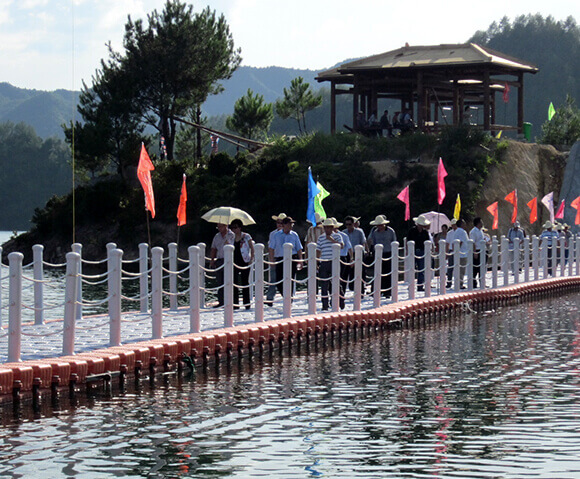 People walking on the floating bridge in scenic
