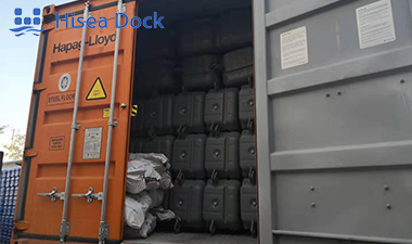 Plastic floating docks in a container ready for shipment