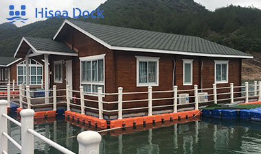 Floating homes attached to plastic floating docks