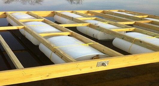 Floating dock barrels