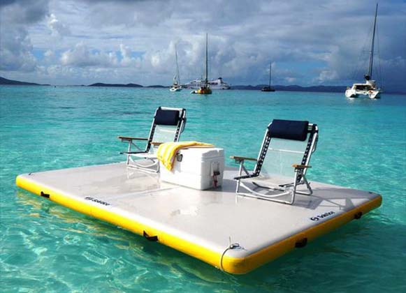 An inflatable floating dock with two chairs