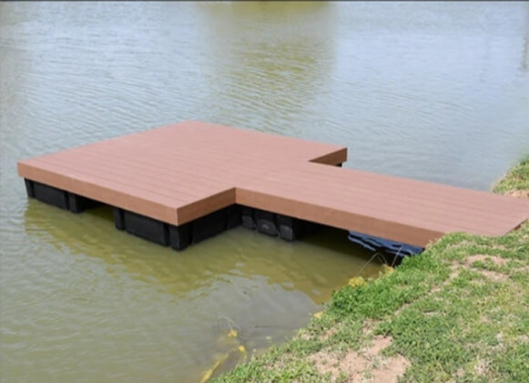 A wooden floating dock for ponds and lakes