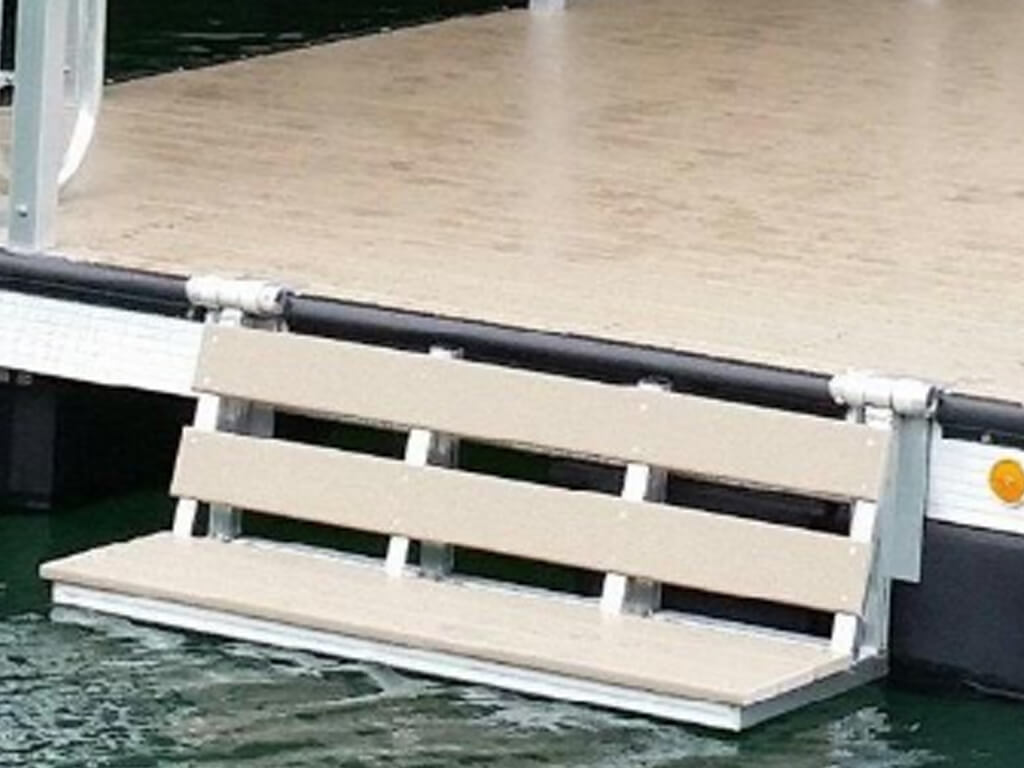 A close up image of a water dock bench