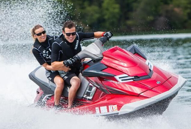 Two Persons Having Fun Jet Skiing