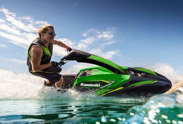 Riding a stand up Kawasaki jet ski