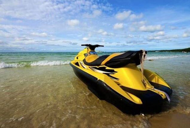 Yellow jet ski on a beach