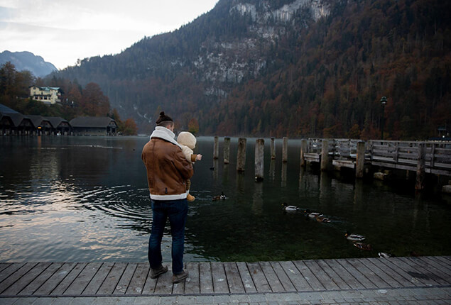 Father and Baby on Wooden Dock