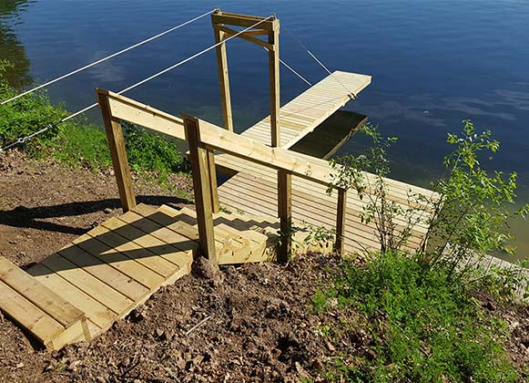 A Suspension Dock Hanging Above The Water Surface