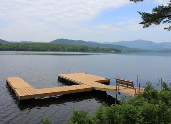 A Wooden Dock Overlooking A Lake