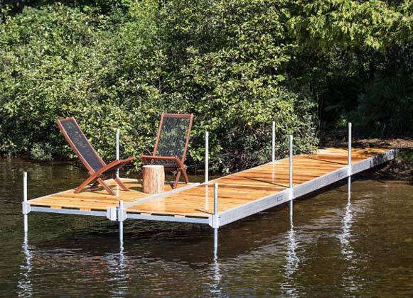 An Aluminum Dock with 2 Resting Chairs
