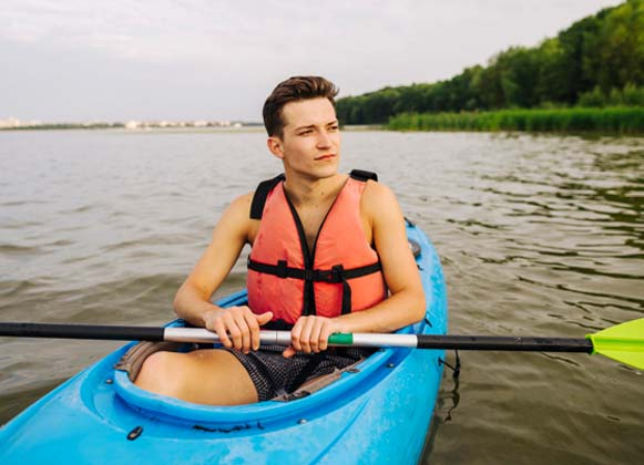 A person with a life vest kayaking