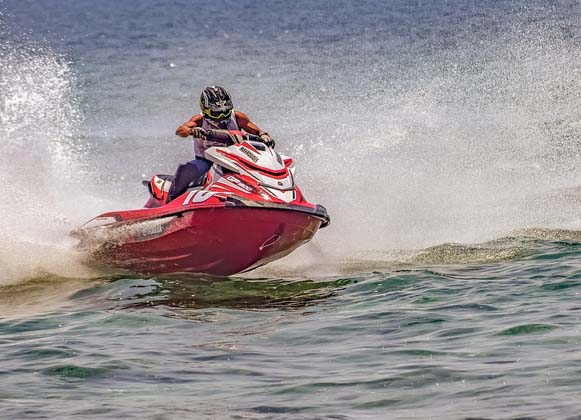 A person riding a personal watercraft