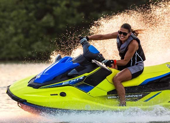 A woman enjoying her jet ski ride