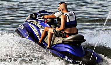 Riding a jet ski on a river