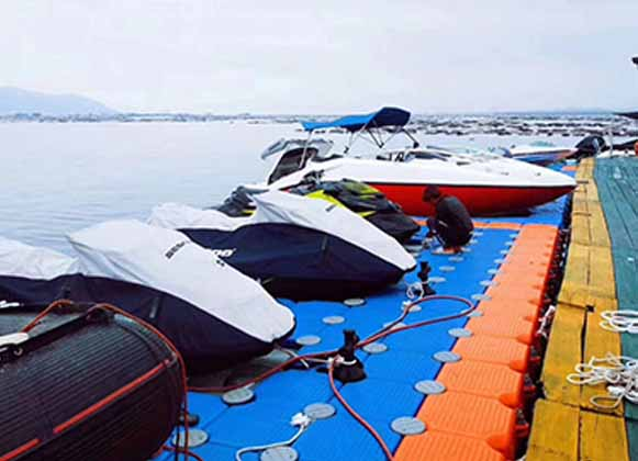 Boats Parked on Floating Dock