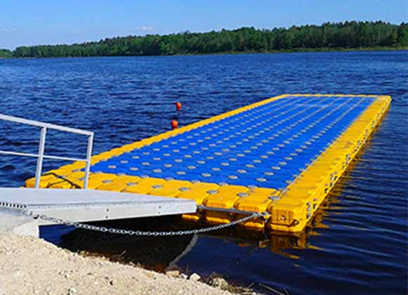 A blue and yellow plastic floating dock