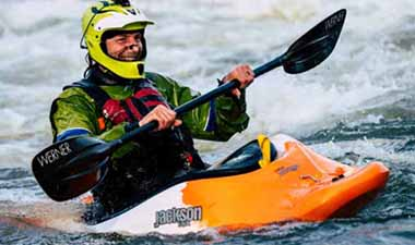 Man riding a kayak
