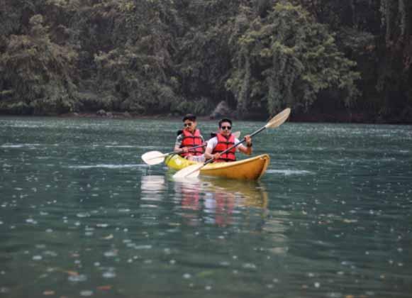 Two people in tandem kayak