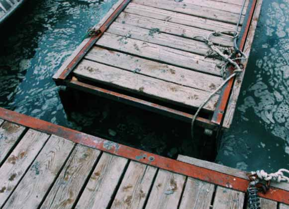 An image of a disconnected wooden floating dock