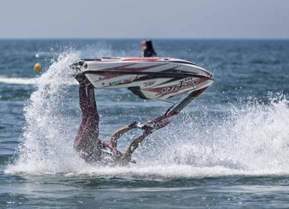 Jet-ski rider falling off a jet ski