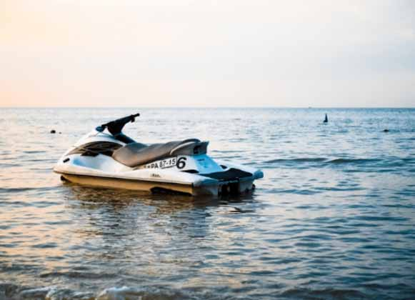 A jet ski without a rider at the beach