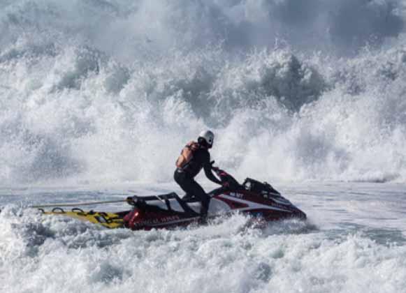 Jet skier riding waves