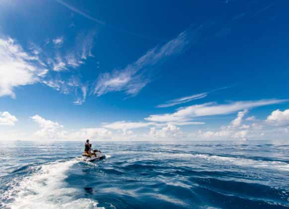 Jet skiers sailing away