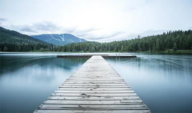 A grey wooden sea dock